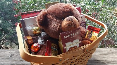 A Teddy Bear and Chocolates Make a Great Gift Basket