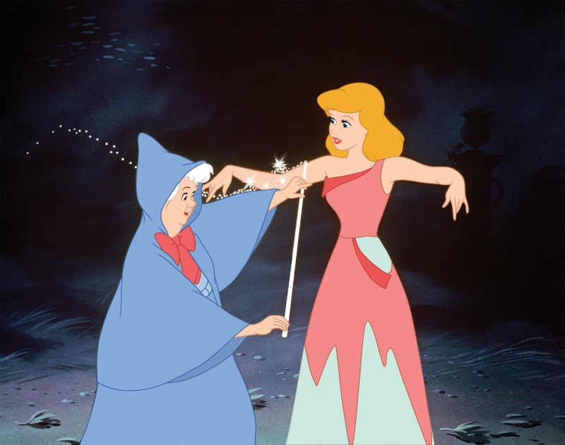 fairy godmother measuring cinderella for her gown
