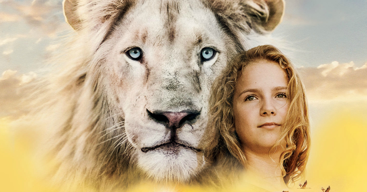 close up of mia and the white lion