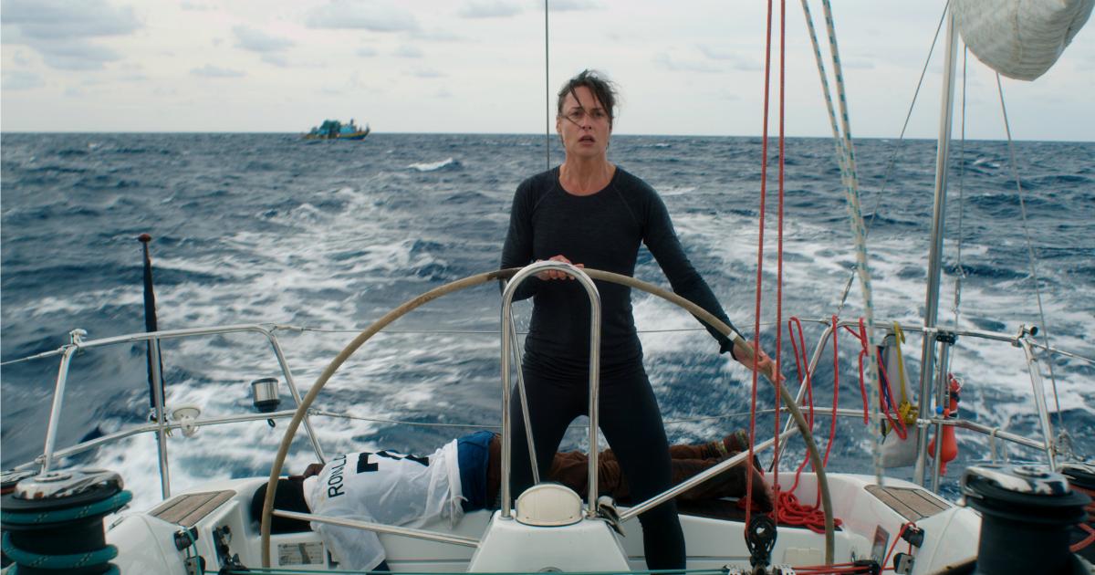 woman steering a boat on rough seas styx movie scene