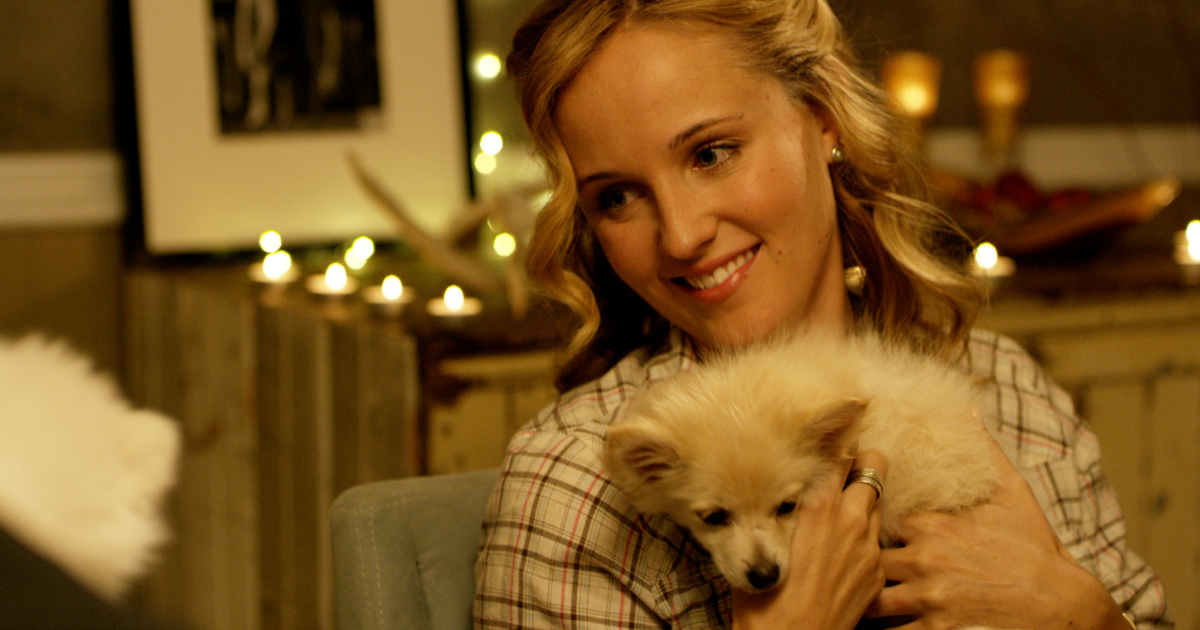 blonde woman with little white dog