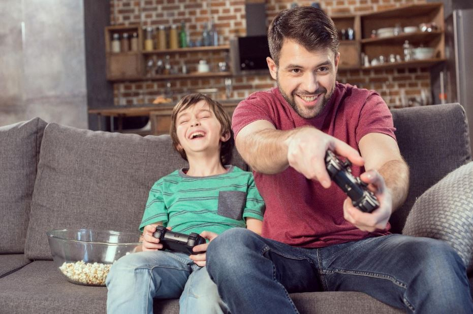 dad playing video games with son