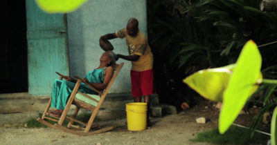 haitian man washing womans hair