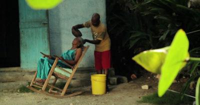 haitian man washing womans hair
