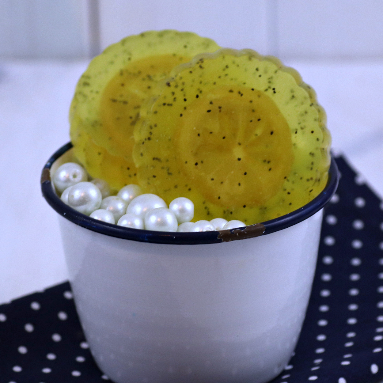 lemon poppyseed soap in white soap dish
