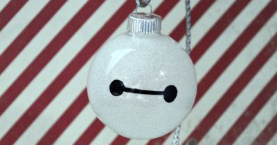 baymax ornament on candy cane striped background
