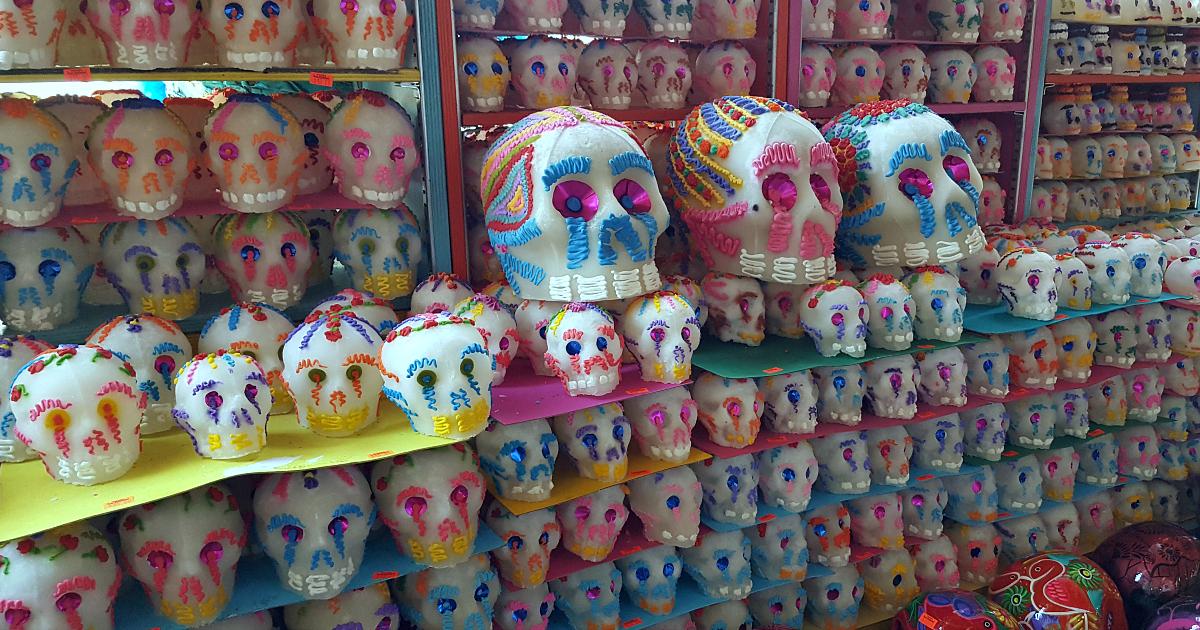 display of sugar skulls at mexican market
