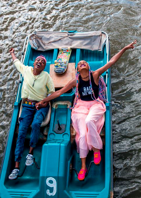 happy couple on pedal boat