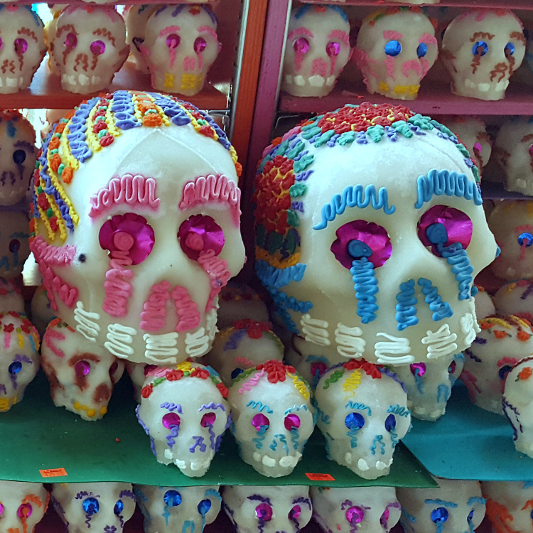pink and blue sugar skull display