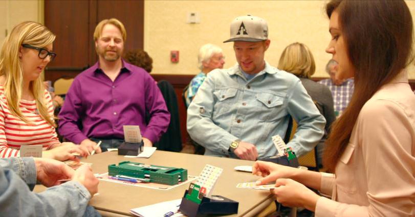 group of people playing bridge