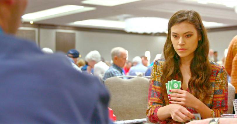 intense young woman playing bridge