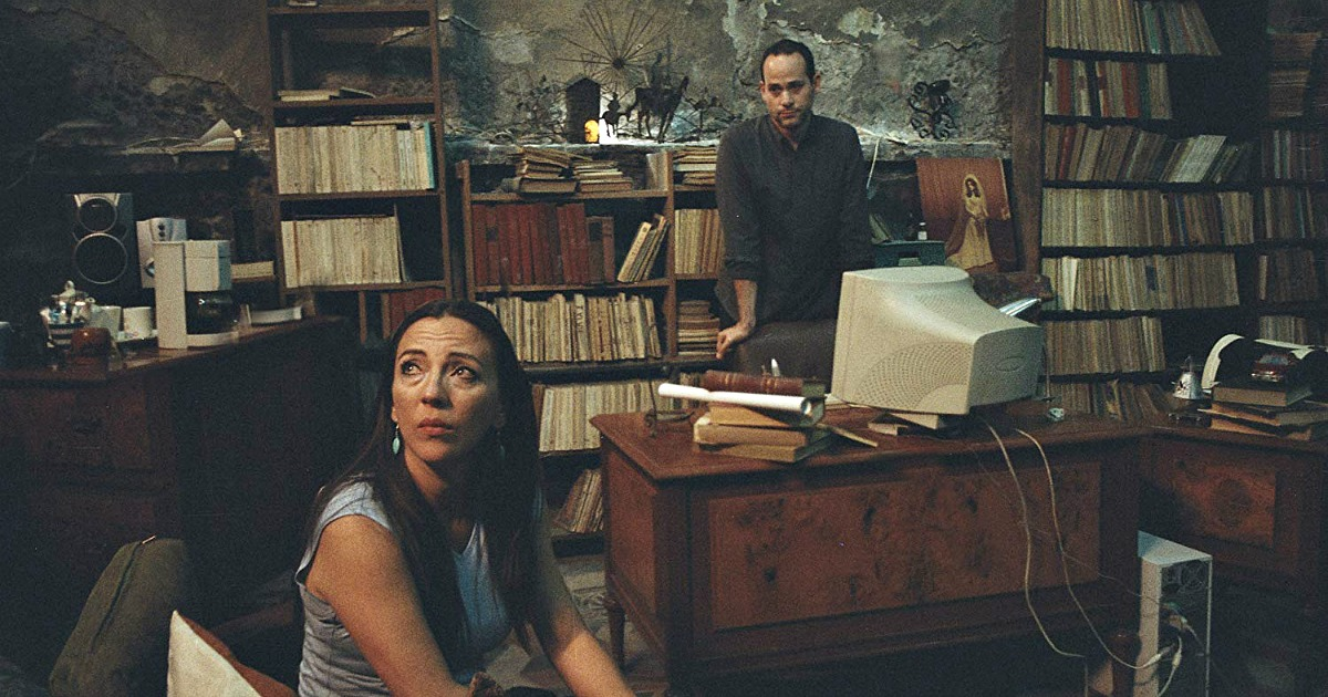 woman and man in office with old books on shelves