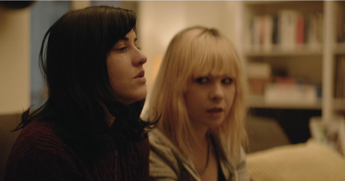 women in scene from family horror movie