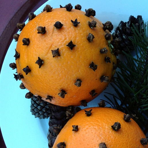 orange with cloves stuck in it