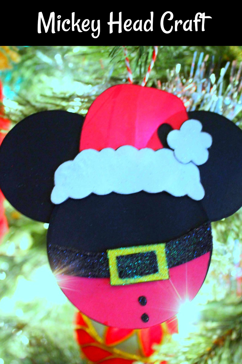 pin santa mickey ornament on tree