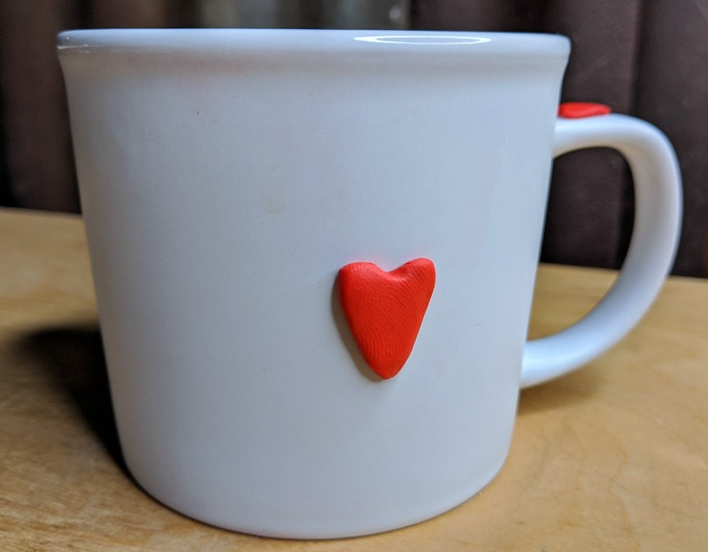 white mug with heart design