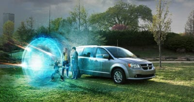 ari robot and kids next to minivan