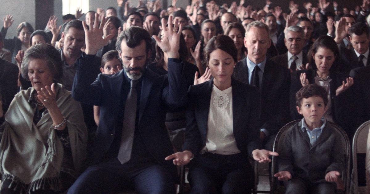 audience praying in church