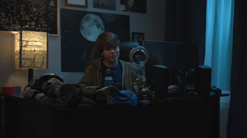 boy in the dark with tech equipment