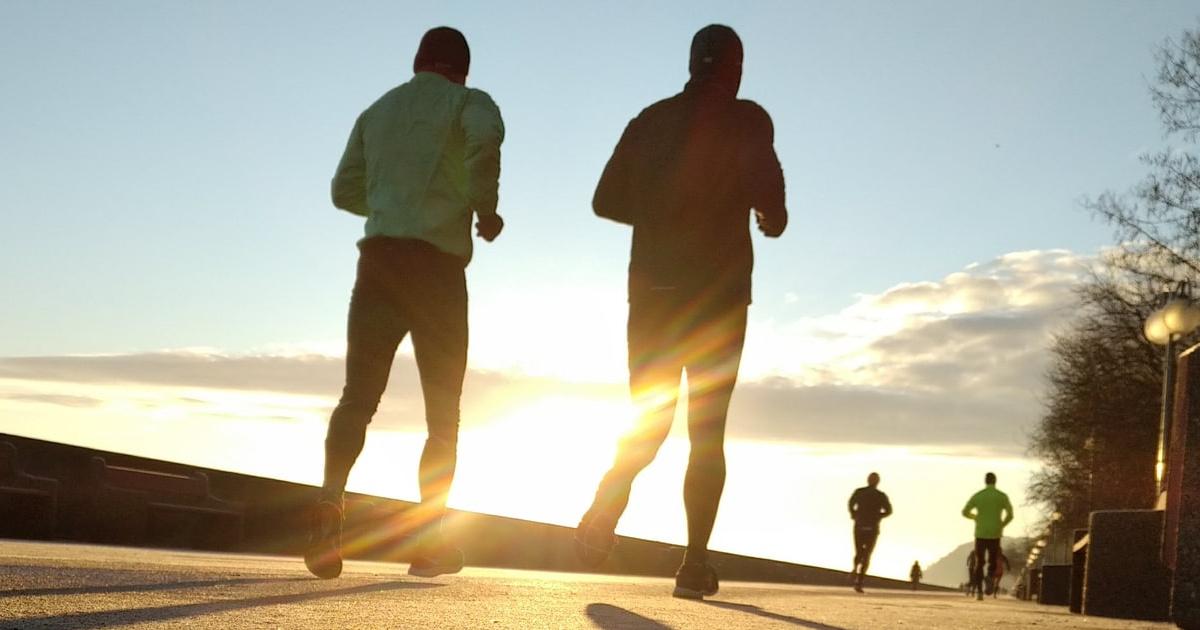 men running on pavement