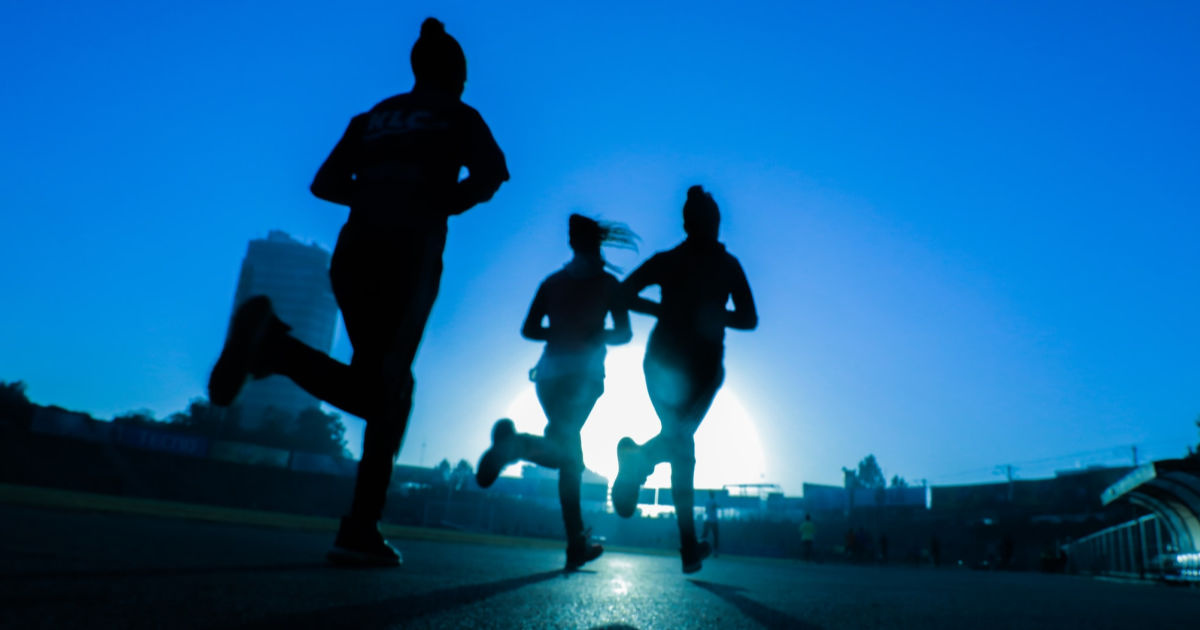 women running at twilight