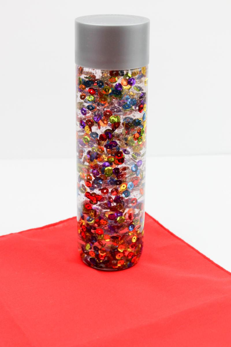 Rainbow Sensory Bottle Craft #SensoryBottle #RainbowSensoryBottle #CalmDownJar #RainbowCalmDownJar #RainbowCraft #SensoryCraft