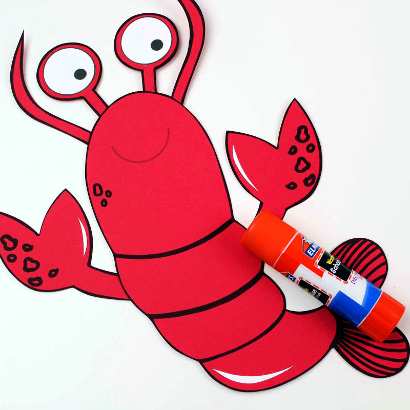 gluing lobster paper craft together