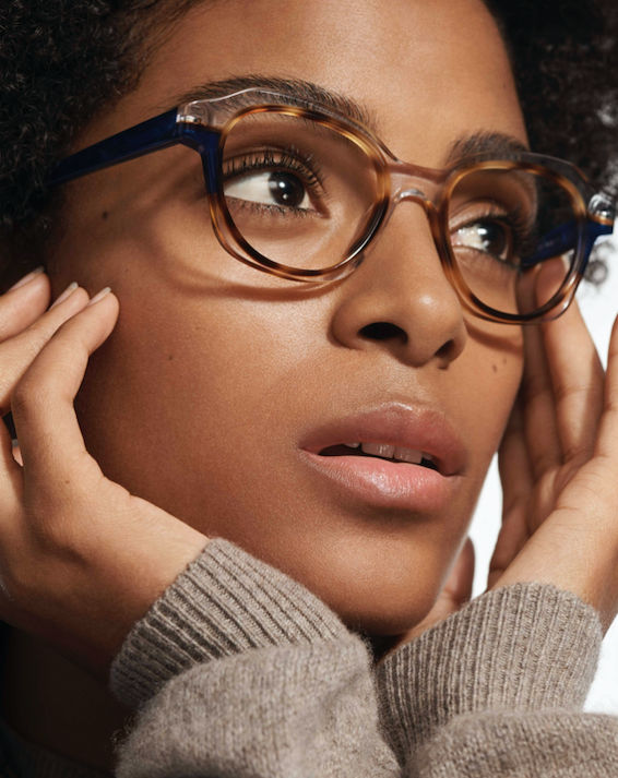 Woman wearing Warby Parker glasses