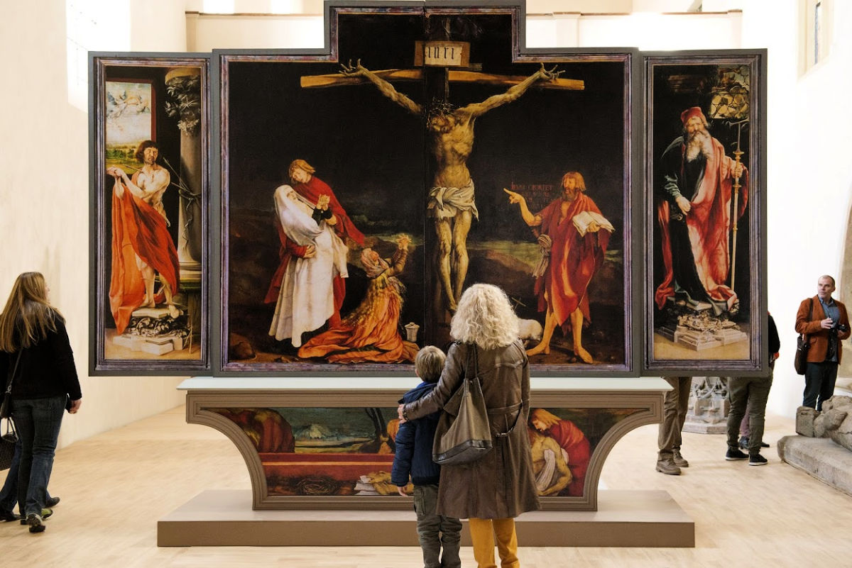 woman and boy looking at religious art