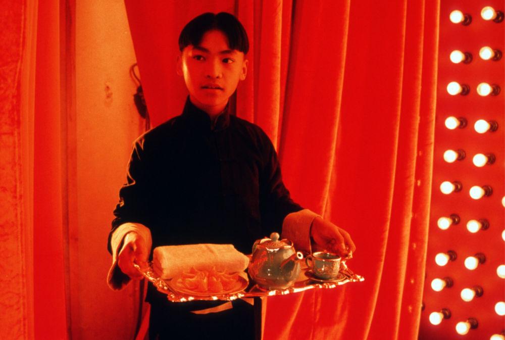 chinese boy serving tea