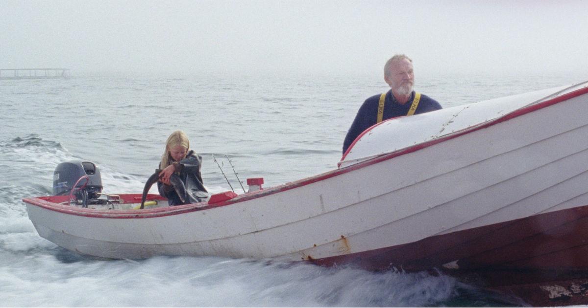 grandpa and granddaughter in boat