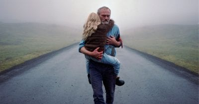 man carrying granddaughter