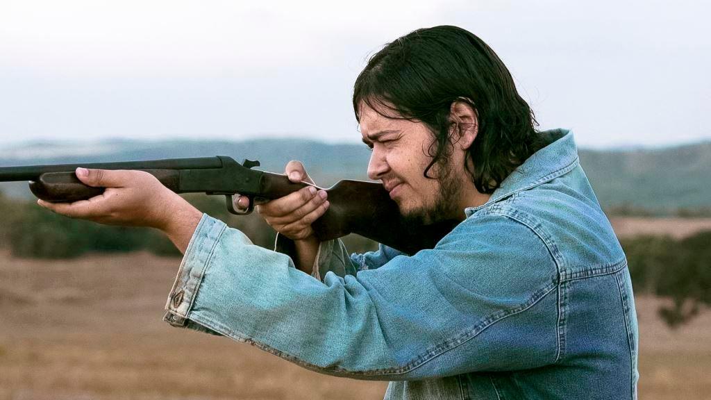 brazilian man aiming rifle