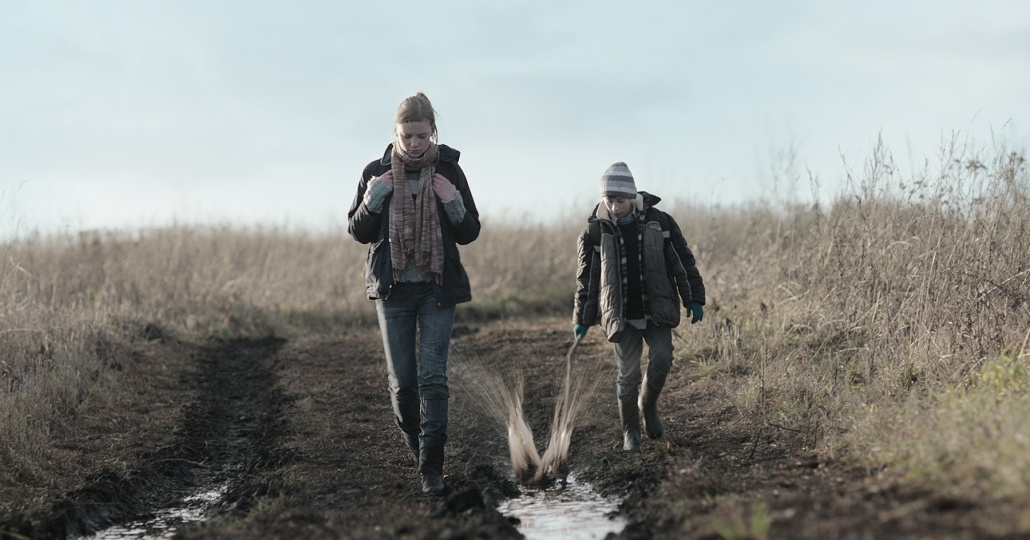 brother and sister walking in mellow mud movie