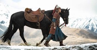 winter scene of mulan walking with horse