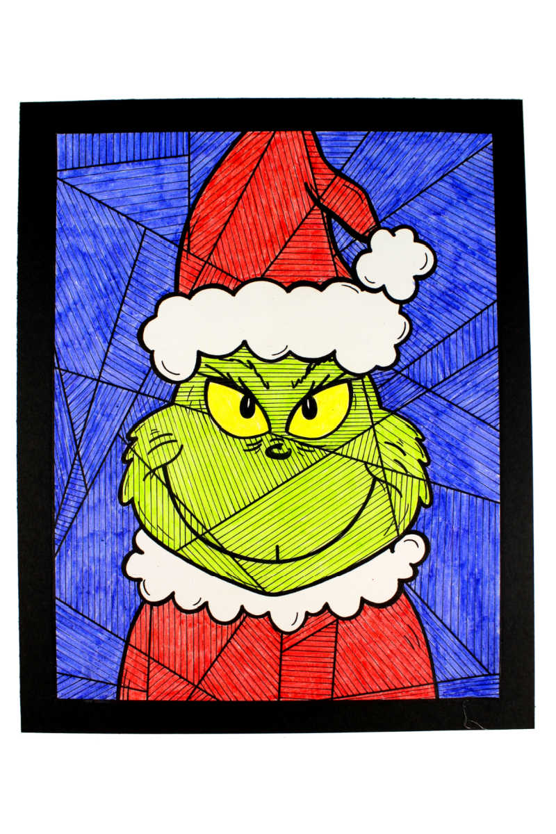 Make your How the Grinch Stole Christmas family night even more fun, when you download my free printable Grinch coloring page.