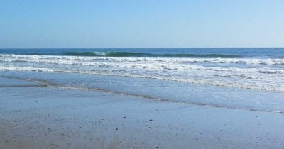small waves rolling onto the shore