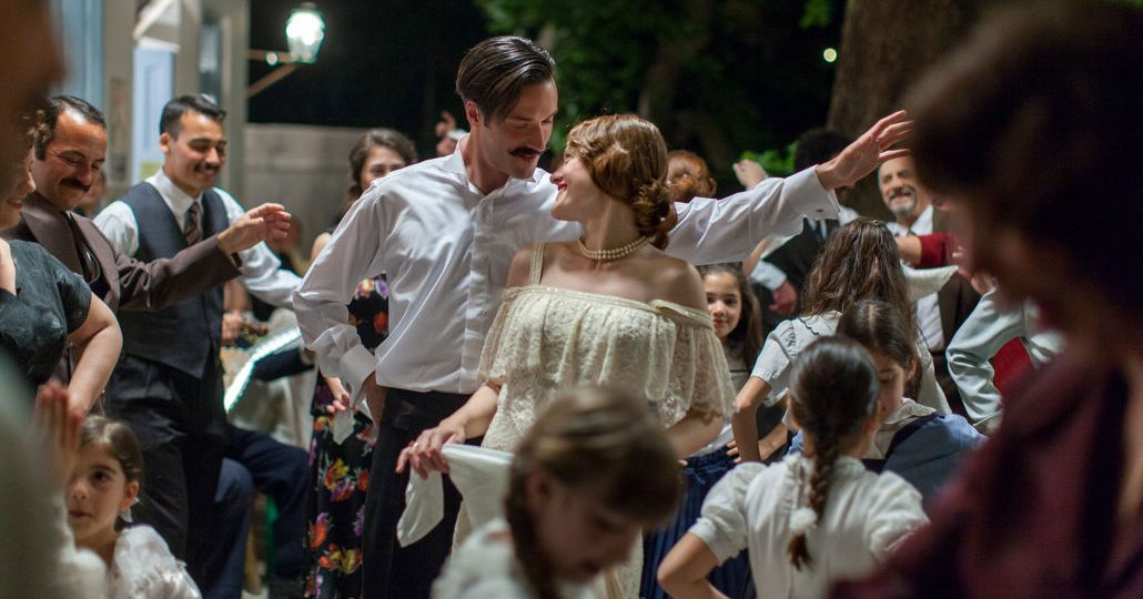 couple dancing at party in greece.