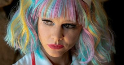 promising young woman with multicolored hair.
