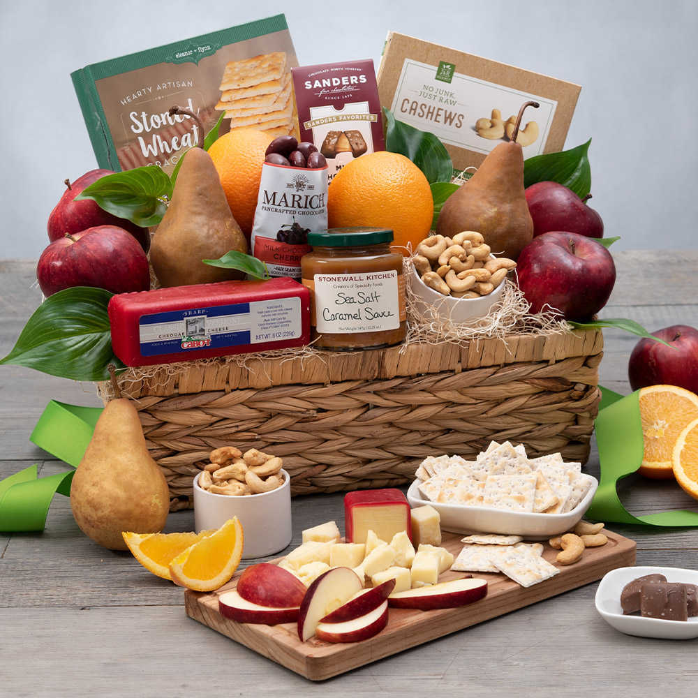 mothers day gift basket with fruit and snacks.
