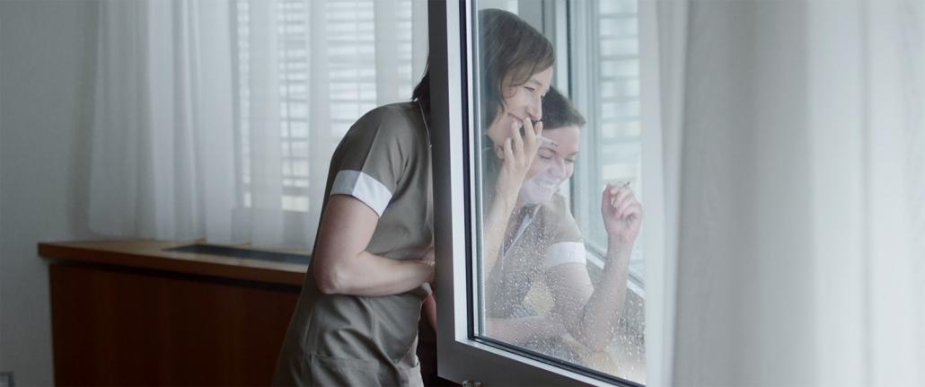 women smoking and laughing.
