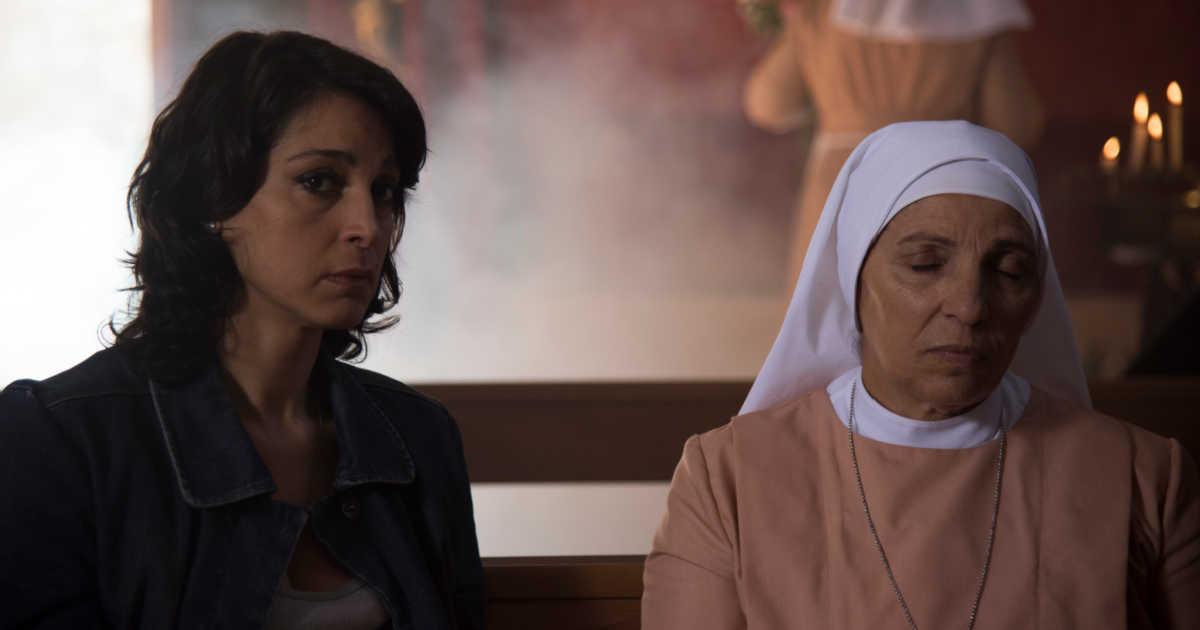 woman sitting with nun in italian church.