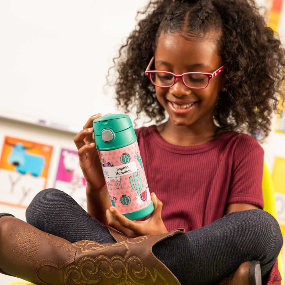 girl at school with reusable water bottle.