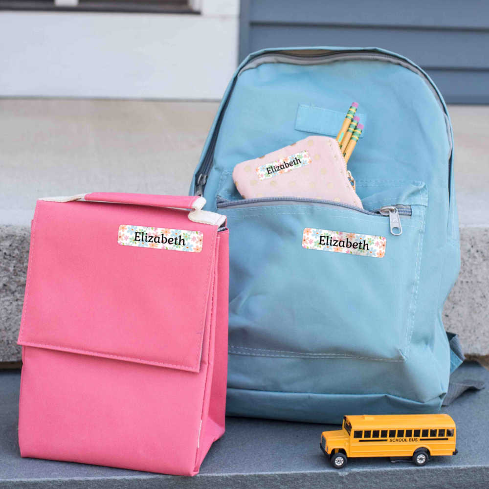 lunch bag and backpacks with name bubble labels