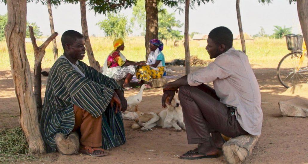men talking in ghana