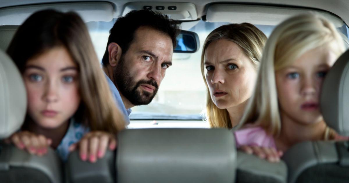 scared dutch family in car