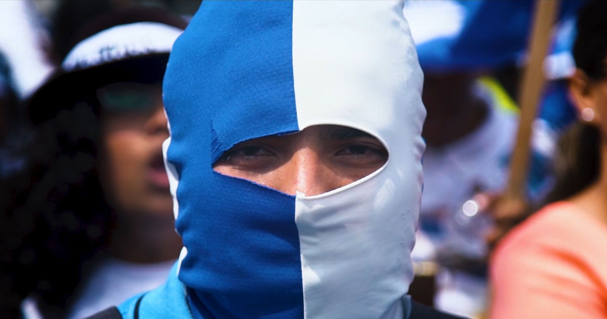 masked man in documentary